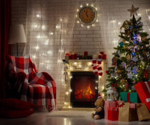 The perfect Christmas, photo shows beautiful living room setting with decorated tree, fireplace and cosy fireside chair.