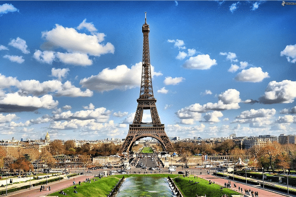 Photo of Eiffel Tower and surrounding Paris. One place I dreamed was PARIS, because of classroom French classes. Mrs. Walker's black and white pictures of the sidewalk cafes, the Eiffel Tower, and Notre Dame inspired me.